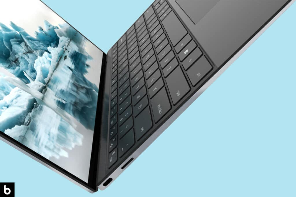 This is the cover photo for our Best Laptops for College Students in 2021 Buying Guide. It features a Dell XPS 13 laptop hovering in limbo, with a sky blue background.