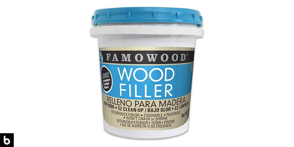 This is a product image in our Best Wood Filler 2021 article. It is a photo of a bucket of FamoWood Latex Filler overlaid on a minimalistic white background with a Burbro logo.
