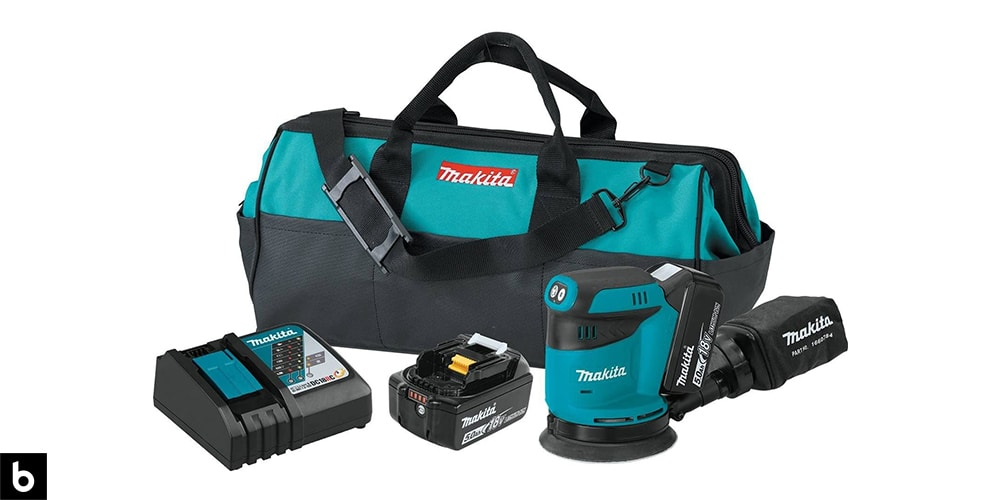 This is a product image in our Best Palm Sander 2021 article. It is a picture of a Makita XOB01T Palm Sander kit. There is also a carrying bag, battery pack, and charging port in the photo.
