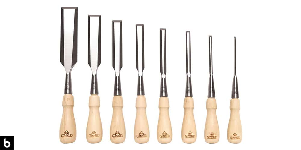 This is a photo of the Stanley Sweetheart Chisel Set, which we've chosen as the best chisel set for woodworking in 2021. The chisels have a light-color wood handle with a stainless-steel shaft. This image is overlaid on a white minimalistic background with a Burbro logo in the corner.