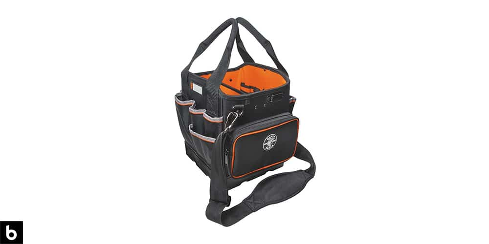 This is a picture of an orange and black Kleins Electricians Tool Bag overlaid on a white background.