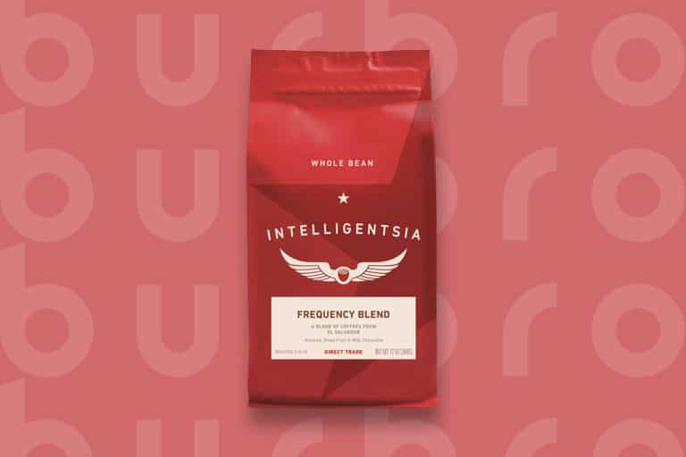 This is the cover photo from our Best Coffee Beans article. It features a red-colored bag of Intelligentsia beans overlaid on a red background with embossed Burbro logo.