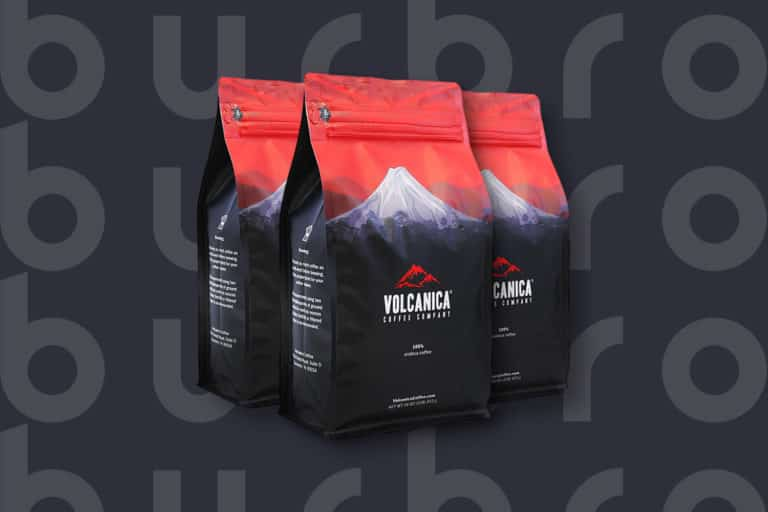This is the cover photo for our Best Coffee for Cold Brew article. It features a red and navy bag of Volcanica coffee beans.