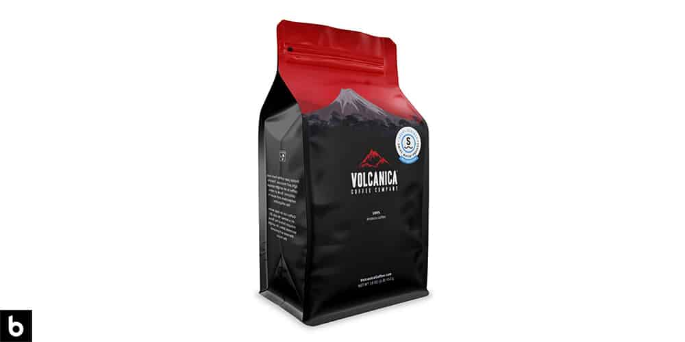 This is a product image, featuring a black and red bag of Costa Rica Volcanica Coffee.