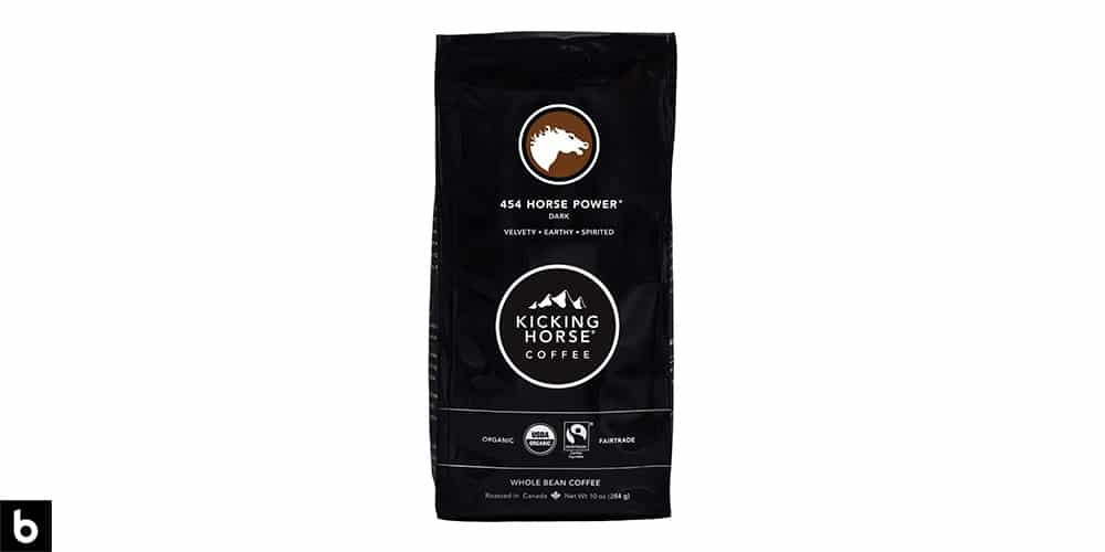 This is a product photo, featuring a black bag of Kicking Horse '454 Horse Power' Dark Roast Coffee.