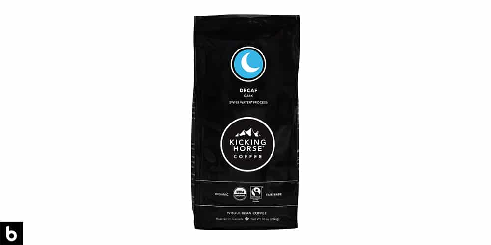 This is a product photo, featuring a black and blue bag of Kicking Horse Dark Roast Decaf Coffee.