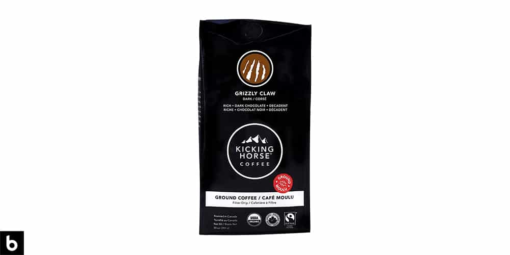 This is a product image for our Best Dark Roast Coffee 2021 article. It features a black bag of Kicking Horse 'Grizzly Claw' dark roast coffee.