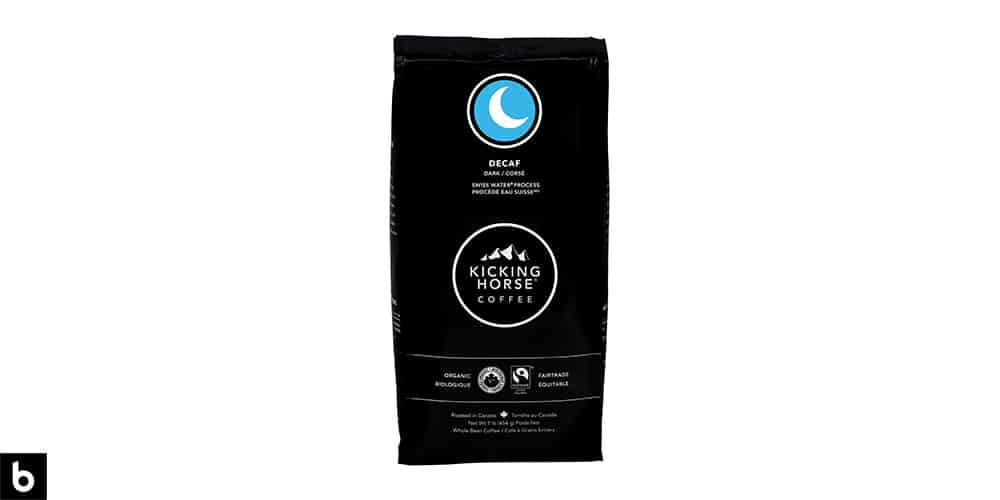 This is a product photo, featuring a black and blue bag of Kicking Horse decaf coffee.