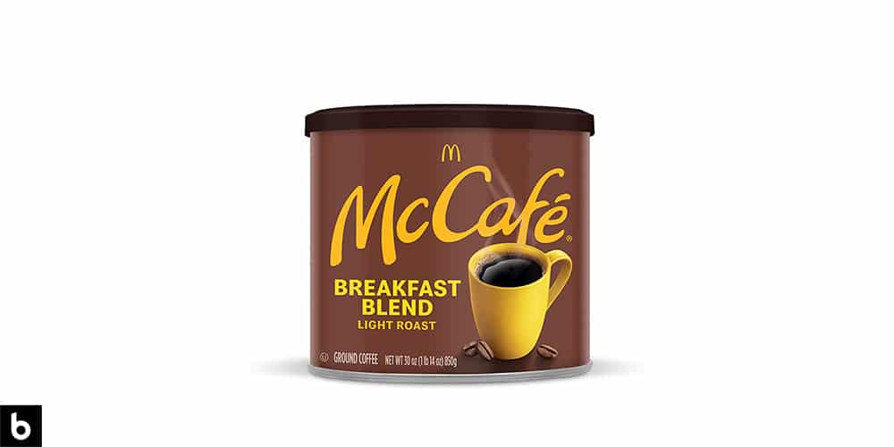 This is a product image of a tin of McDonald's McCafe breakfast blend coffee.