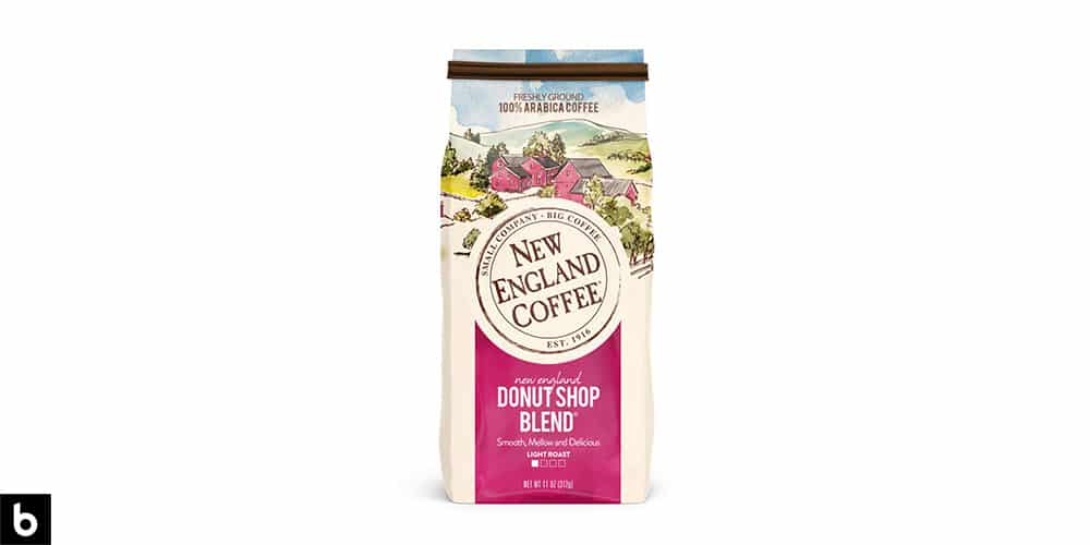 This is a product image, featuring a bag of New England Coffee Donut Shop Blend Light Roast Coffee. The bag is cream and pink colored, with a picture of a rural farm.