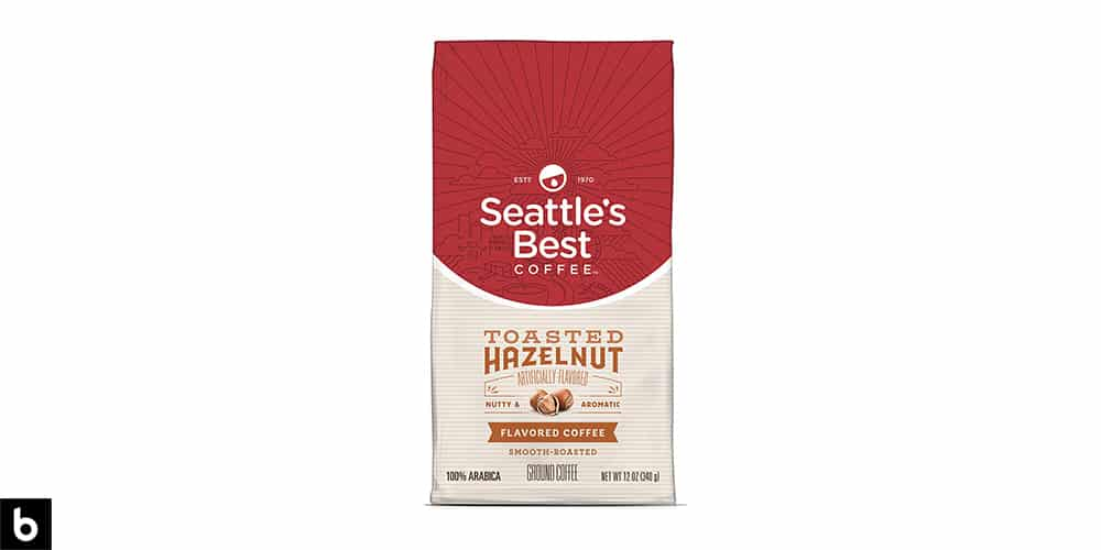 This is a product photo for our Best Ground Coffee 2021 article. It features a red and cream bag of Seattle's Best Toasted Hazelnut ground coffee.