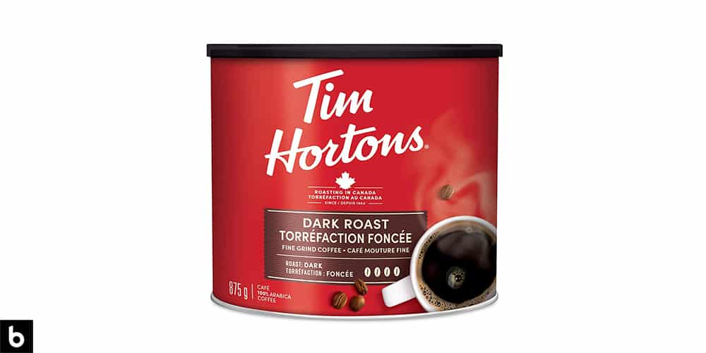 This is a product photo of a red can of Tim Horton's dark roast coffee.