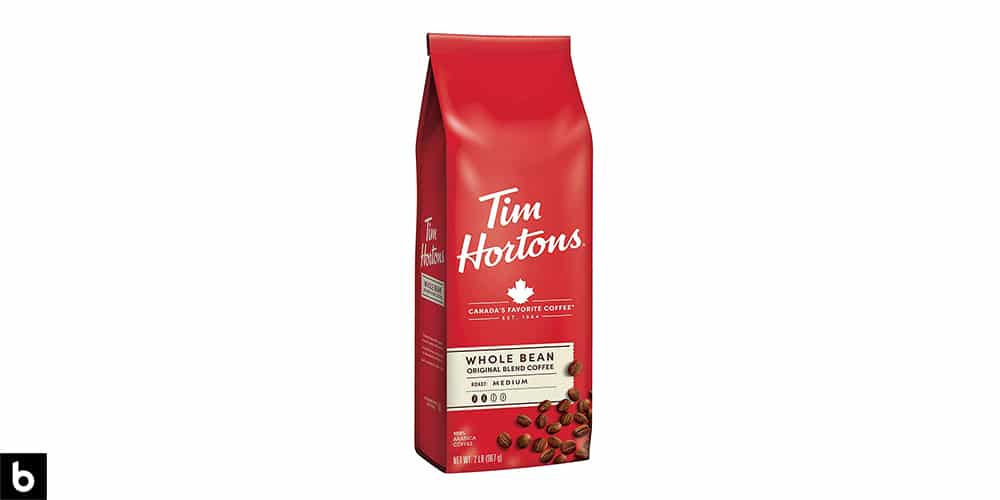 This is a product image for our Best Budget Coffee 2021 article. It features a red and white bag of Tim Horton's Whole Bean Original Blend Medium Roast Coffee.